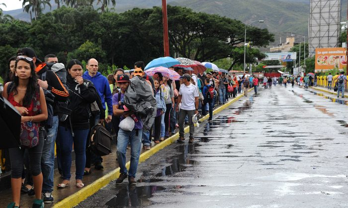 Venezuelans cross the Simon Bolivar bridge linking San Antonio del Tachira, in Venezuela with Cucuta, Colombia, to buy basic supplies on July 16, 2016. Thousands of Venezuelans crossed into the Colombian city of Cucuta to buy food and medicine, taking advantage of another brief opening in the border that's been closed nearly a year. Caracas authorized the temporary opening a week after some 35,000 Venezuelans poured across the border during a 12-hour opening of the pedestrian bridge. (George Castellanos/AFP/Getty Images)