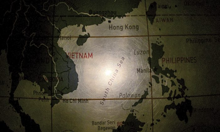 An illuminated globe shows the South China Sea at a museum in Pathumthani, Thailand. (Charles Dharapak/AP Photo)