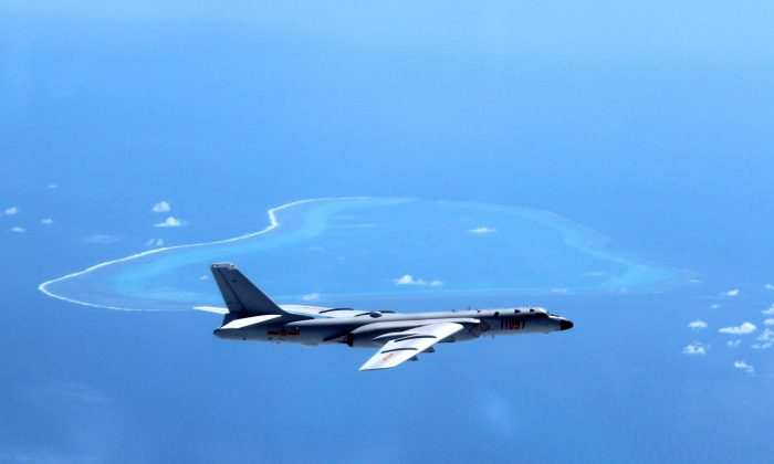 A Chinese H-6K bomber patrols the islands and reefs in the South China Sea. (Liu Rui/Xinhua via AP)
