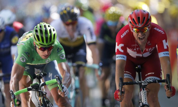 Peter Sagan Tinkoff, wearing the best sprinter's green jersey, crosses the finish line ahead of Katusha's Alexander Kristoff to win Stage 16 of the 2016 Tour de France, 209 kilometers (129.9 miles) from Moirans-en-Montagne to Bern, Switzerland, Monday, July 18, 2016. (AP Photo/Christophe Ena)
