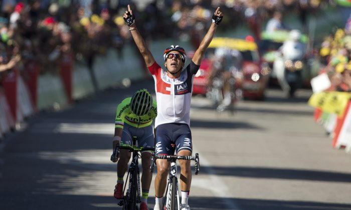 IAM's Jarlinson Pantano celebrates as he crosses the finish line ahead of Tinkoff's Rafal Majka to win Stage 15 of the 2016 Tour de France, 160 kilometers (99.4 miles) from Bourg-en-Bresse to Culoz, France, Sunday, July 17, 2016. (AP Photo/Peter Dejong)