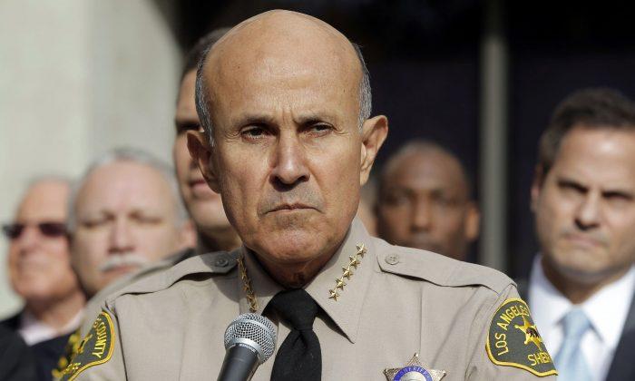 Los Angeles County Sheriff Lee Baca announces his retirement at Sheriff's Headquarters Bureau in Monterey Park, Calif on Jan. 7, 2014. (AP Photo/Nick Ut, File)
