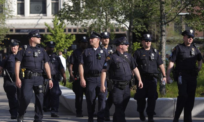 Police officers patrol around the Cleveland Public Square in preparation for the Republican National Convention on July 15, 2016, in Cleveland, Ohio. (DOMINICK REUTER/AFP/Getty Images)