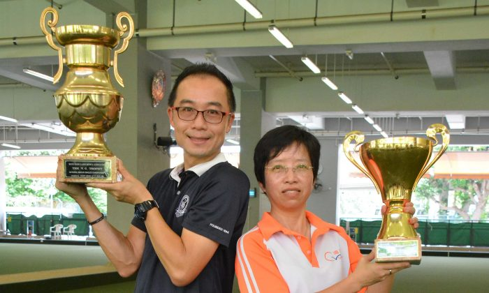 Stanley Lai and Queenie Lai display their trophies after winning the Indoor Singles Finals, at Club de Recreio on Saturday July 16, 2016. (Stephanie Worth)