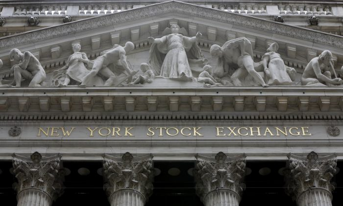 New York Stock Exchange, on Oct. 4, 2014. Venture capital backed exits through initial public offerings or mergers and acquisitions fell sharply in the first half of 2016. (AP Photo/Richard Drew)