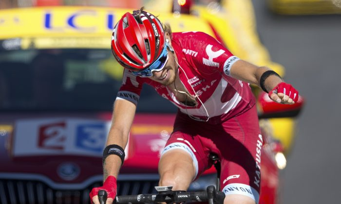 Katusha's Ilnur Zakarin celebrates as he crosses the finish line to win Stage 17 of the Tour de France, 184.5 kilometers (114.3 miles) from Bern to Finhaut-Emosson, Switzerland, Wednesday, July 20, 2016. (AP Photo/Peter Dejong)