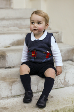 In this handout image of three released on December 13, 2014 by Kensington Palace, Prince George sits for his official Christmas picture in a courtyard at Kensington Palace in late November of 2014 in London, England. (The Duke and Duchess of Cambridge/PA Wire via Getty Images)