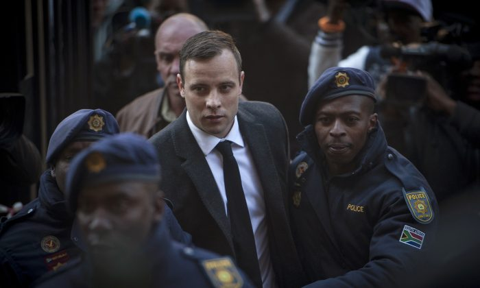 "FILE - In this July 6 2016 file photo Oscar Pistorius, center, arrives at the High Court in Pretoria, South Africa where he was sentenced to six years for the the killing of his girlfriend Reeve Steenkamp. The National Prosecuting Authority says it is going to appeal the jail sentence, stating that it was ""shockingly too lenient"". (AP Photo/Shiraaz Mohamed, File)"