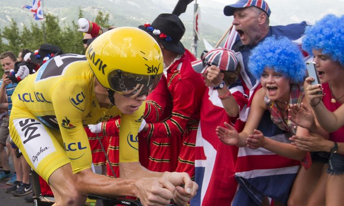 Britain's Chris Froome, in the overall leader's yellow jersey, climbs during Stage 18 of the Tour de France, a 17-km (10.6 miles) individual time trial from Sallanches to Megeve, France, Thursday, July 21, 2016. (AP Photo/Peter Dejong)