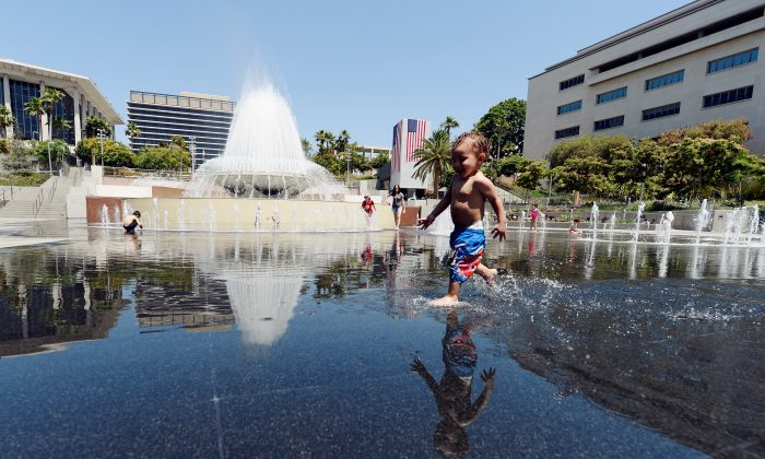 Ali Zenaidi, 2, cools off in the Arthur J. Will Memorial Fountain inside Grand Park during a major heat wave in Southern California in downtown Los Angeles, California in this file photo. (Kevork Djansezian/Getty Images)