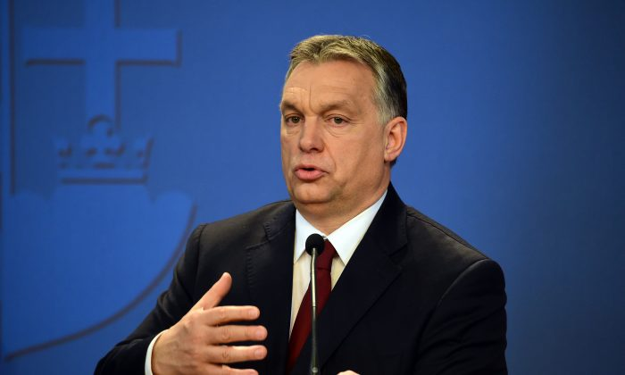 Hungary's Prime Minister Viktor Orban answers to journalists during the joint press conference, with German Bavarian State Premier Horst Seehofer (unseen), in Budapest, on March 4, 2016. (Attila Kisbenedek/AFP/Getty Images)