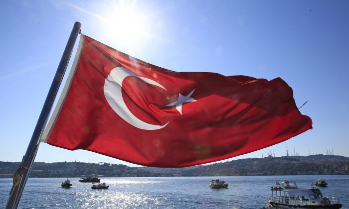 A Turkish flag flies near the Bosporus strait prior to the Bosporus Cross-Continental Swimming Race in Istanbul, Turkey, on July 24, 2016. (AP Photo/Lefteris Pitarakis)