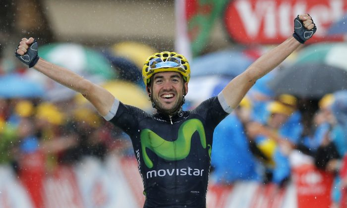 Movistar's Jon Izaguirre celebrates as he crosses the finish line to win Stage 20 of the Tour de France, 146.5 kilometers (90.7 miles) from Megeve to Morzine-Avoriaz, France, Saturday, July 23, 2016. (AP Photo/Christophe Ena)