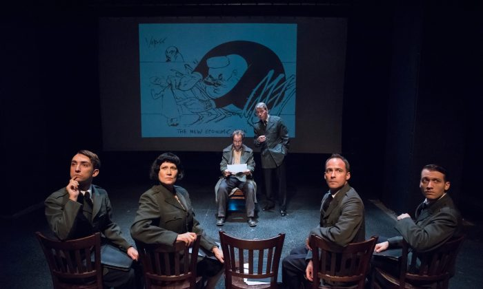 """(L–R, Forefront)Soviet Comrades (Alexander Burnett, Valerie Leonard, Christopher Marshall, and Christo Grabowski). (L–R, Back) Cartoonist Bela Veracek (Alex Draper) and his cartoon (by Gerald Scarfe)are a little too direct in their political commentary, a point made by a Soviet officer (Jonathan Tindle) in """"No End of Blame."""" (Stan Barouh)"""