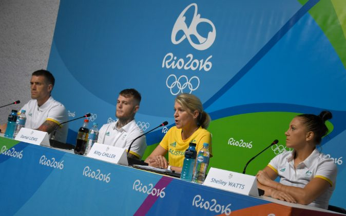 The Chef de Mission for Australia at the 2016 Rio Olympic Games, Kitty Chiller (C),with Athletes Jason Whateley (L), Daniel Lewis (2nd L) and Shelley Watts(R)speaks to the press on July 25, 2016, after Australia decided not to move into the Olympic Village in Rio de Janeiro until it is completely ready to receive its athletes. (VANDERLEI ALMEIDA/AFP/Getty Images)