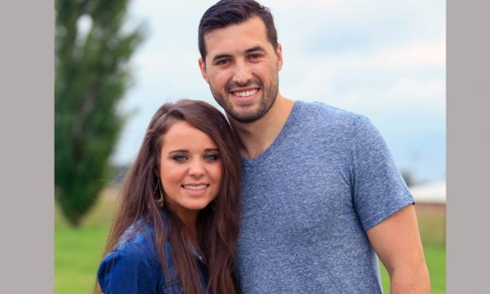 """This undated image released by TLC shows Jinger Duggar, left, and former professional soccer player Jeremy Vuolo, stars of the reality series, """"Counting On."""" Duggar announced her engagement to Vuolo in a video posted Tuesday, July 26, 2016, promoting the series, which premiers next month. (Julia Myers/TLC via AP)"""