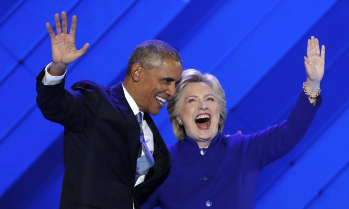 Barack Obama and Hillary Clinton wave to delegates after Obama's speech during the Democratic National Convention in Philadelphia, on July 27, 2016. (J. Scott Applewhite/AP Photo)