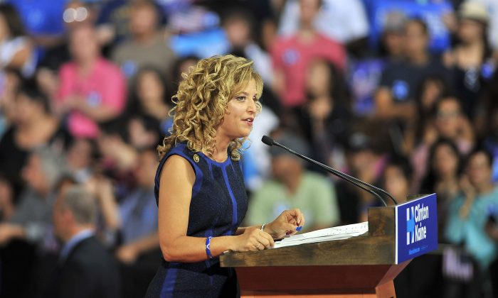 Democratic National Committee Chair, Congresswoman Debbie Wasserman Schultz of Florida addresses a campaign rally for Democratic presidential candidate Hillary Clinton and running mate Tim Kaine at Florida International University in Miami, Florida, July 23, 2016.  Embattled Democratic Party chair Debbie Wasserman Schultz said July 24, 2016 she is resigning, following a leak of emails suggesting an insider attempt to hobble the campaign of Hillary Clinton's rival in the White House primaries Bernie Sanders.  / AFP / Gaston De Cardenas        (Photo credit should read GASTON DE CARDENAS/AFP/Getty Images)