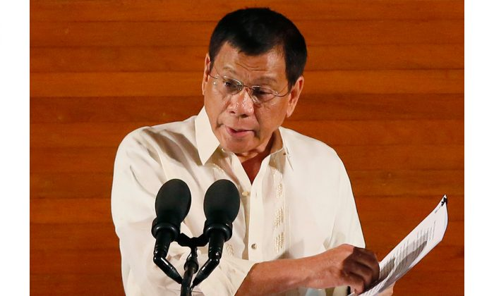 Philippine President Rodrigo Duterte delivers his first State of the Nation Address before the joint session of the 17th Congress in suburban Quezon city, northeast of Manila, Philippines, on July 25, 2016. (AP Photo/Bullit Marquez)