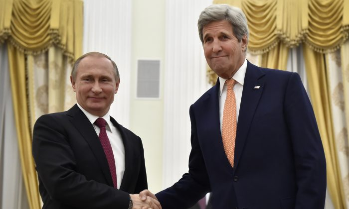 Russian President Vladimir Putin (L) shakes hands with U.S. Secretary of State John Kerry during a meeting at the Kremlin in Moscow, on March 24, 2016. (Alexander Nemenov/AFP/Getty Images)