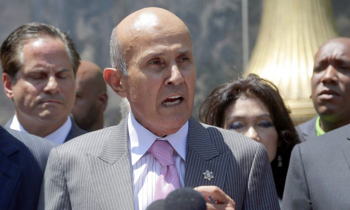 Former Los Angeles County Sheriff Lee Baca speaks to the media after leaving federal court in Los Angeles, Monday, Aug. 1, 2016. Baca withdrew a guilty plea Monday and chose to go to trial on a charge of lying to federal authorities in an effort to thwart an FBI investigation into abuses at the jails he ran.  (AP Photo/Nick Ut)