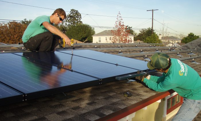 Workers from Solarcity install solar panels on a home in California in this file photo.  (Steve & Michelle Gerdes/Flickr/CC BY-NC-ND)