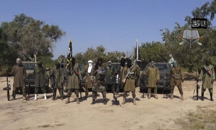In this file image taken from video released Oct. 31, 2014, by Boko Haram, Abubakar Shekau, centre, the leader of Nigeria's Islamic extremist group.  (Boko Haram, via AP, File)