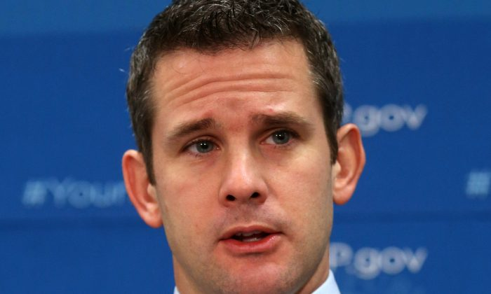 U.S. Rep. Adam Kinzinger (R-Ill.) speaks to the media after attending the weekly House Republican conference at the U.S. Capitol, Oct. 29, 2013 in Washington. (Mark Wilson/Getty Images)