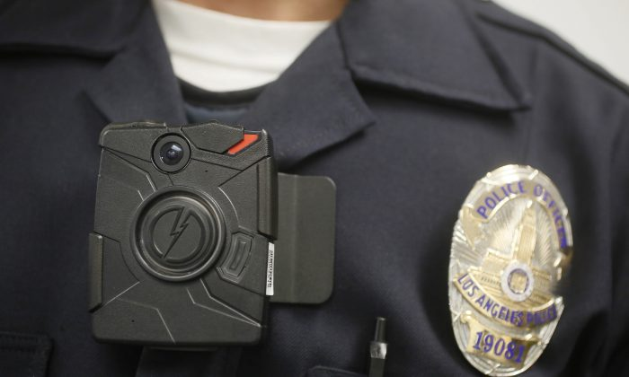 In this Jan. 15, 2014, file photo, a Los Angeles Police officer wears an on-body camera during a demonstration in Los Angeles. (AP Photo/Damian Dovarganes)