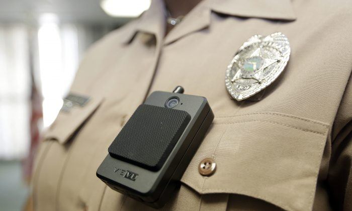 A body camera is worn by Miami-Dade Police Department PIO Marjorie Eloi, which 1,000 officers will begin using over the next few months, during a news conference, Thursday, April 28, 2016, in Doral, Fla. (AP Photo/Lynne Sladky)