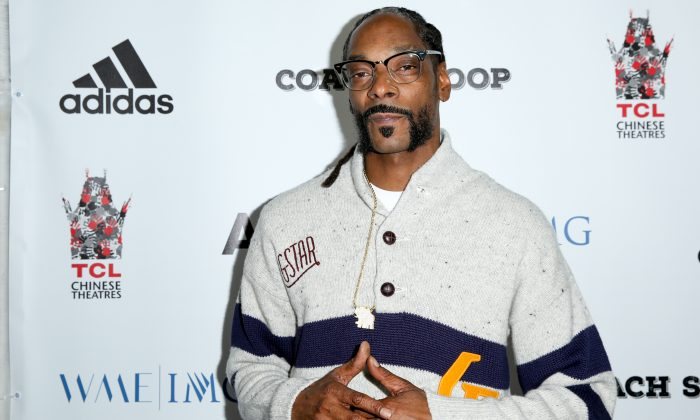 "Snoop Dogg arrives at the LA Premiere of ""Coach Snoop"" at the TCL Chinese 6 Theatres in Los Angeles on May 16, 2016. (Photo by Rich Fury/Invision/AP)"