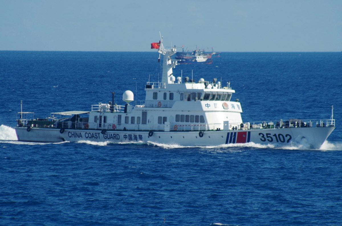 A Chinese coast guard vessel sails near disputed East China Sea islands on Aug. 6, 2016. Japan's Foreign Ministry said in a statement it filed the protest after Japan's coast guard spotted the vessels Saturday along with a fleet of 230 Chinese fishing boats swarming around the Japanese-controlled Senkaku Islands. China also claims the islands, calling them the Diaoyu. (11th Regional Coast Guard Headquarters via AP)