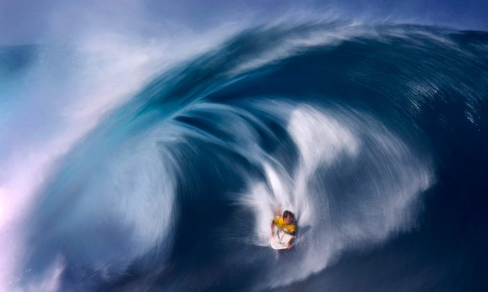 Ryan Hardy of Australia bodyboards a large wave while competing at Rockstar Games Pipeline Pro Bodyboarding contest at the Pipeline on the North Shore of Oahu, Hawaii, on Jan. 12, 2007. (Donald Miralle/Getty Images)