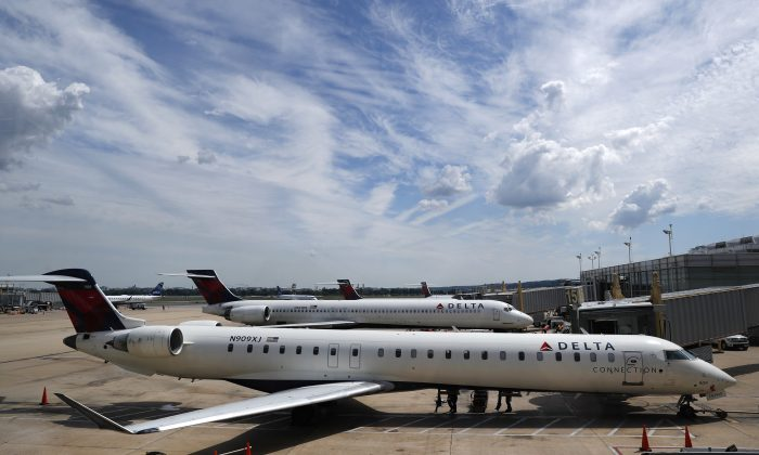 Delta Air Lines planes at the tarmac at Washington's Ronald Reagan Washington National Airport on Aug. 8, 2016. Delta Air Lines delayed or canceled hundreds of flights Monday after its computer systems crashed, stranding thousands of people on a busy travel day. (AP Photo/Carolyn Kaster)