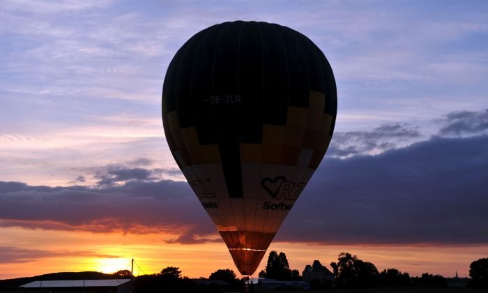 A hot-air-balloon prepares to take off for the launch of the France Ballooning Championship in Mirebeau, France, on Aug. 10, 2016. (Guillaume Souvant/AFP/Getty Images)