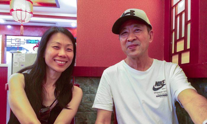 Wang Xiaodan with her father Wang Zhiwen in China. (courtesy of Wang Xiaodan/Epoch Times)