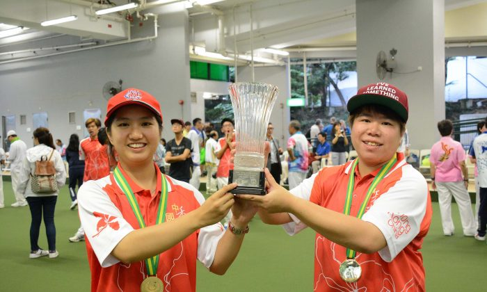 Hong Kong Youth Team member Amy Choi (left) and Vivian Yip proudly display their women's pairs trophy after defeating the Australian team in the final of the Hong Kong International Bowls Classic 2015.  They will be looking at repeating the miracle again this year. (Stephanie Worth)