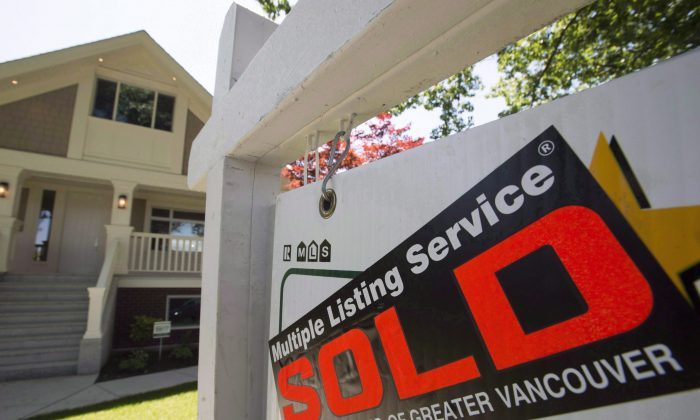 A sold sign outside a home in Vancouver on June 28, 2016. After the introduction of a tax on foreign buyers, the next issue to resolve is the lack of housing supply. (The Canadian Press/Jonathan Hayward)