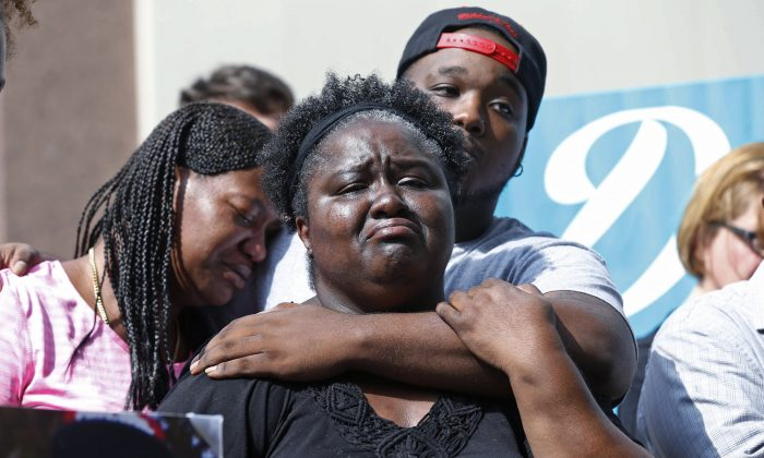Matrice Stanley, center, sister of Donnell Thompson, who was fatally shot by Los Angeles County Sheriff's deputies in Compton, Calif., with her son and Thompson's nephew, Joseph Gay, rear, and Thompson's sister, Antoinette Brown, left, speak to reporters outside the County Hall of Administration after addressing county supervisors in downtown Los Angeles Aug. 9, 2016. The Sheriff's Department earlier Tuesday had acknowledged that Thompson was not involved with a carjacker who had fired at pursuers when he was shot and killed on July 28, 2016. (AP Photo/Nick Ut)