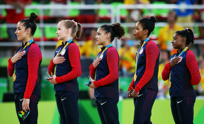 (L to R) Gold medalists Alexandra Raisman, Madison Kocian, Lauren Hernandez, Gabrielle Douglas and Simone Biles of the United States pose for photographs with their medals after the medal ceremony for the Artistic Gymnastics Women's Team on Day 4 of the Rio 2016 Olympic Games at the Rio Olympic Arena in Rio de Janeiro, Brazil on August 9, 2016. (Laurence Griffiths/Getty Images)