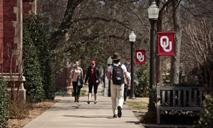 Students walk on campus between clases at the University of Oklahoma in Norman, Okla., on March 11, 2015. (Brett Deering/Getty Images)
