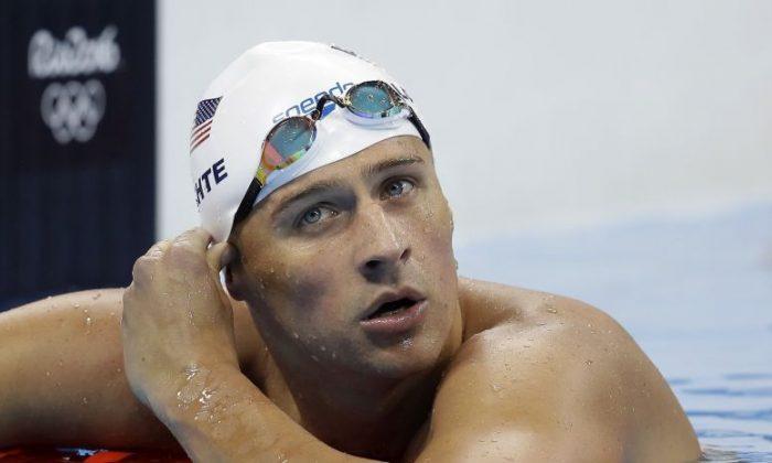 United States' Ryan Lochte checks his time in a men's 4x200-meter freestyle heat on Aug. 9, 2016. (AP Photo/Michael Sohn, File)