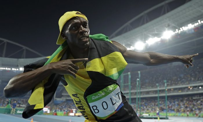 Jamaica's Usain Bolt celebrates after winning the gold in the men's 100-meter final during the athletics competitions in the Olympic stadium of the 2016 Summer Olympics in Rio de Janeiro, Brazil, Sunday, Aug. 14, 2016. (AP Photo/Matt Slocum)