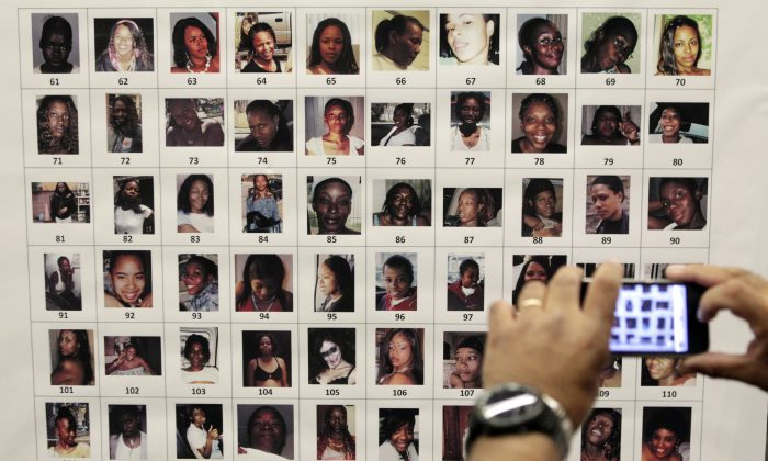 GRIM SLEEPER--In this Dec. 16, 2010, file photo, photographs found in the possession of Lonnie David Franklin Jr. are displayed at a police news conference in Los Angeles. (AP Photo/Jae C. Hong, File)