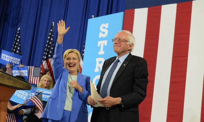 Hillary Clinton and Bernie Sanders at Portsmouth High School July 12, 2016 in Portsmouth, New Hampshire. (Photo by Darren McCollester/Getty Images)
