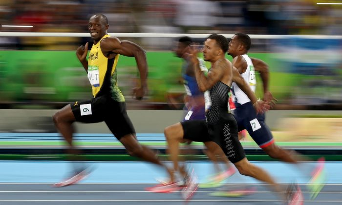 Usain Bolt of Jamaica sprints ahead to win gold in the Men's 100 meter semifinal on Day 9 of the Rio 2016 Olympic Games in Rio de Janeiro, Brazil, on Aug. 14, 2016. (Cameron Spencer/Getty Images)