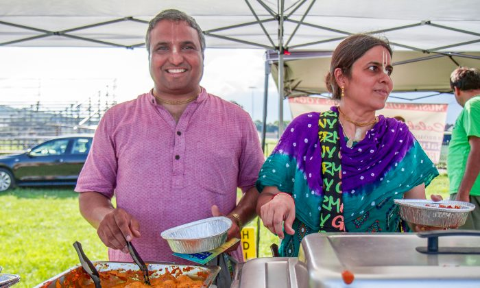 Dr. Ashik Raval (L) and Jalangi Raval from Nimai's Bliss Kitchen vegan restaurant at the Hudson Valley Vegan Food Festival in Newburgh on Aug. 14, 2016. (Colin Fredericson/Epoch Times)