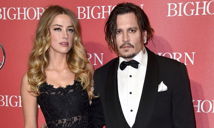 Amber Heard, left, and Johnny Depp arrive at the 27th annual Palm Springs International Film Festival Awards Gala in Palm Springs, Calif. on Jan. 2, 2016. (Photo by Jordan Strauss/Invision/AP)