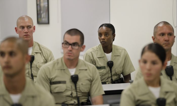 Los Angeles County sheriff's deputy recruit Renata Phillip, third from right, listens to a lecture in a classroom at the Biscailuz Regional Training Center in Monterey Park, Calif. on July 19. (AP Photo/Jae C. Hong)