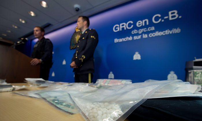 Fake oxycontin pills containing fentanyl are displayed during a news conference at RCMP headquarters in Surrey, B.C., on Sept. 3, 2015. The British Columbia Centre for Excellence in HIV/AIDS is calling for more doctors across Canada to be formally trained to diagnose and treat patients addicted to drugs.  (THE CANADIAN PRESS/Darryl Dyck)